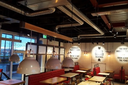 Oakwoods transformed the 2970m2 Sq Ft empty shell to create Smashburgers' signature look with an industrial feel, exposed brickwork and urban graphics.