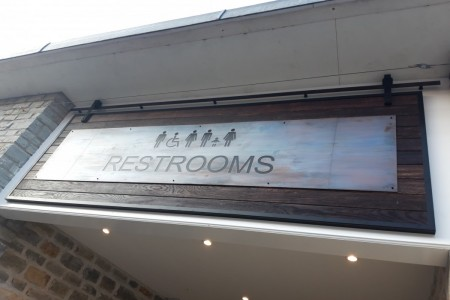 Customer Toilets at Clarks Village, Street, Somerset. Signage