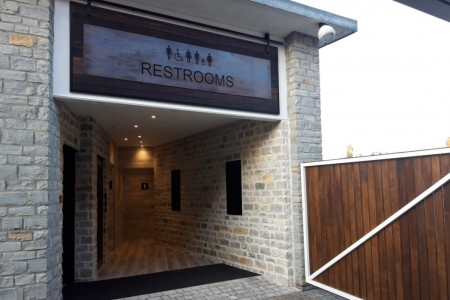 Centre Public Toilets, Clarks Outlet Village, Flooring & Wall Tiling, Signage